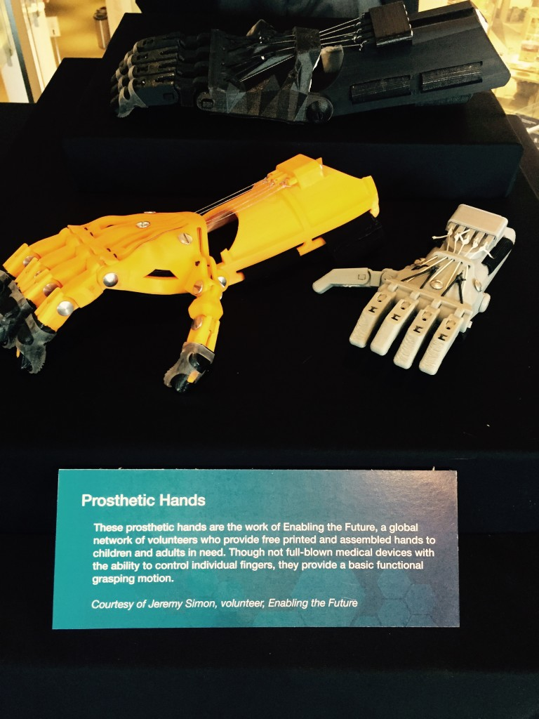 e-NABLE prosthetic device display at 3D print conference in downtown Chicago.
